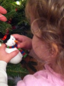 Getting a very close look at her first ornament.